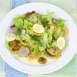 Fresh salad with mushrooms, squid and quail eggs — Stock Photo #59881525
