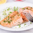 Steamed salmon with fresh herbs and lemon. Rice as a garnish — Stock Photo #59881981