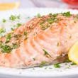 Steamed salmon with fresh herbs and lemon. Rice as a garnish — Stock Photo #59882007