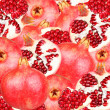 Bstract background with slices of fresh pomegranate. Seamless pattern for a design. Close-up. Studio photography. — Stock Photo #59882817