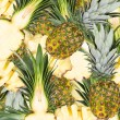 Abstract background with slices of fresh pineapple. Seamless pattern for a design. Close-up. Studio photography. — Stock Photo #59882893
