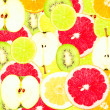 Abstract background with slices of fresh fruits. Seamless pattern for a design. Close-up. Studio photography. — Stockfoto #59883117