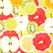 Abstract background with slices of fresh fruits. Seamless pattern for a design. Close-up. Studio photography. — Photo #62003977