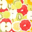 Abstract background with slices of fresh fruits. Seamless pattern for a design. Close-up. Studio photography. — Stockfoto #62003977