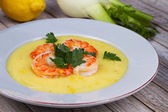 Fennel and potato cream soup with shrimps — Stock Photo