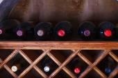 Wine bottles stored in a shelves — Stock Photo