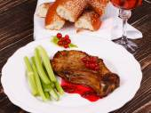 Fried pork chop with red currant sauce and celery — Stock Photo
