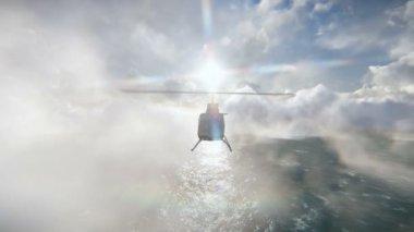 Helikopter flyger över havet — Stockvideo