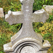 Stone cross on the tombstone in the cemetery — Stock Photo #67813477