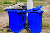 Wheeled garbage cans on the street — Stock Photo