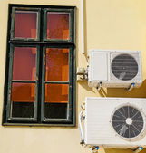Air conditioner on the wall of a building — Stock Photo