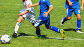 Soccer players in action — Stock Photo