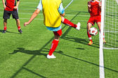 Striker is kicking a goal at the soccer match — Stock Photo