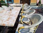 Dining tables and chairs outdoors — Stock Photo