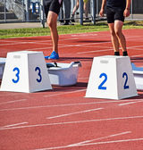 Runners at the starting block — Stock Photo