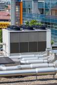 Air conditioners on the top of an office building — Stock Photo
