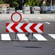 Do not enter and arrow sign at the road crossing — Stock Photo #69194955