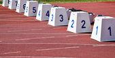 Starting blocks on the running track — Stock Photo