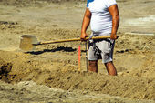 Man is working at the road construction — Stock Photo