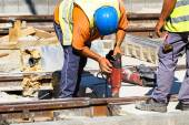 Man is working at the railway conctruction — Stock Photo