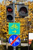 Traffic lights and bicycle road signs — Stock Photo