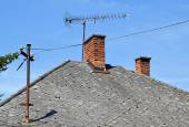 House roof with antennas — Stock Photo