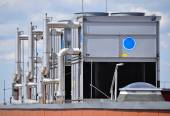 Large industrial air conditioners on the top of a building — Stock Photo