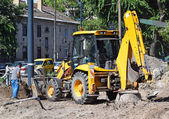 Excavator at the road construction — Stock Photo