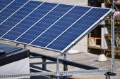 Solar panels on the top of a building — Stock Photo