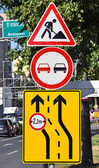 Road works and no overtaking signs at the road construction — Stock Photo