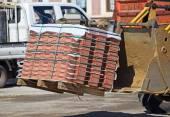 Excavator delivers paving stones — Stock Photo