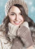 Pretty smiling girl in a knitted hat and a warm sweater. Beauty face — Stock Photo
