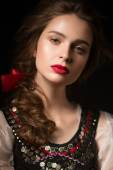Beautiful Russian girl in national dress with a braid hairstyle and red lips. Beauty face. — Stock Photo