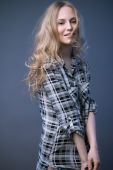 Beautiful blonde girl in a shirt with a light makeup and loose hair. Model tests. — Stock Photo