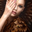 Beautiful girl in the image of the Phoenix with bright makeup, long fingernails and red hair. Beauty face. — Stock Photo #69457953