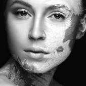 Beautiful girl with mud on his face. Cosmetic mask. Beauty face.  Black&white photo — Stock Photo