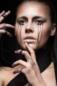 Beautiful girl with creative make-up in Gothic style and the threads of eyes. Art beauty face. — Stock Photo