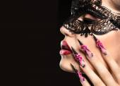 Beautiful girl in mask with long nails and sensual lips. Beauty face. — Stock Photo