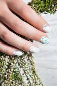 Wedding manicure for the bride in gentle tones with flowers. Nail Design. Close-up. — Stock Photo