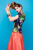 Beautiful fashionable woman an unusual hairstyle in bright clothes and colorful accessories. Cuban style. — Stock Photo