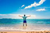 Man enjoying freedom  in water on the beach — Stock Photo