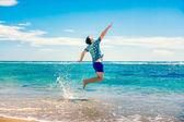 Man having fun at the beach — Stock Photo