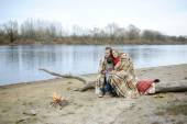 Married couple at the river during the autumn period — Stock Photo