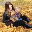 Mother with the son is among autumn foliage — Stock Photo #58152037