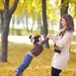 Mother with the son is among autumn foliage — Stock Photo #58152039