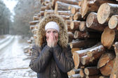 The woman poses against logs — Stock fotografie