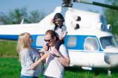 Mother, father, son and helicopter — Stock Photo