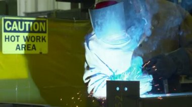 Sparks fly as a welder welds steel — Stock Video