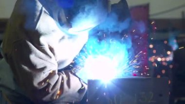 Sparks fly as two welders weld steel. — Stock Video
