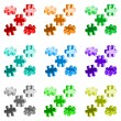 Vector illustration made from four colorful puzzle pieces — Stock Vector #53812231